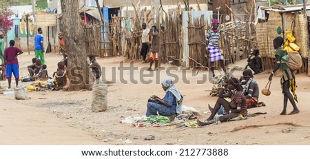 ARBORE. OMO VALLEY. ETHIOPIA - DECEMBER 29, 2013: Unidentified people on street market in small Hamer Village. Most Omo Valley people maintain their traditional way of life. - stock photo