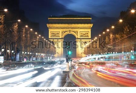Arc De Triomphe and light trails, Paris - stock photo