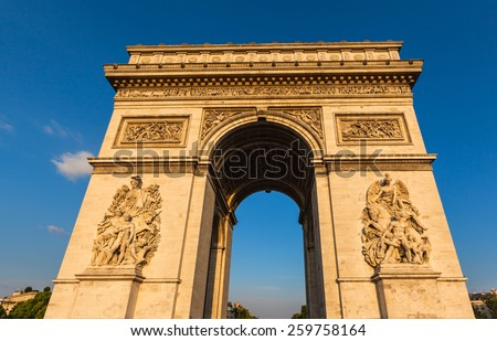 Arc de Triomphe (Arch of Triumph) in the setting sunshine, Paris, France - stock photo