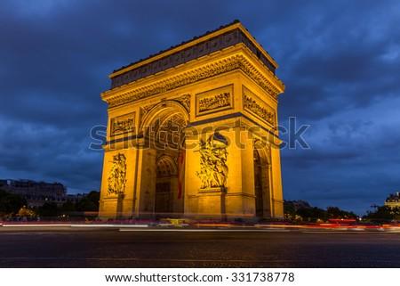 Arc de Triomphe at night in Paris,France - stock photo