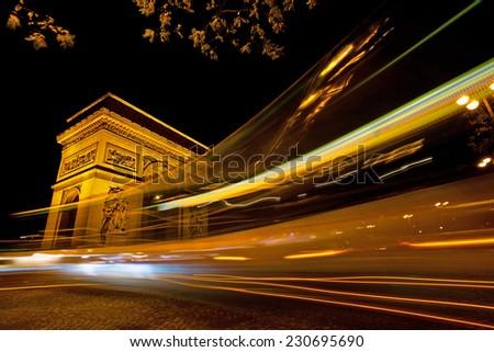 Arc de Triomphe at night / Paris - stock photo