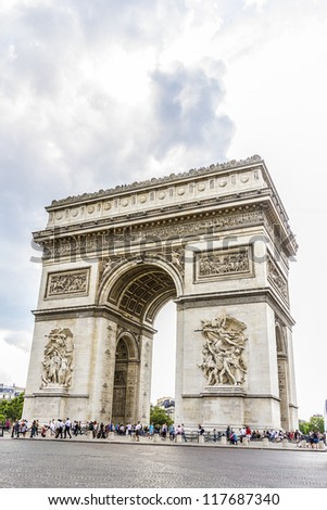 Arc de Triomphe de l'Etoile is one of the most famous monuments in Paris. Arc de Triomphe was built in 1806-1836 by architect Jean Shalgrenom by order of Napoleon to commemorate victories of his Army. - stock photo