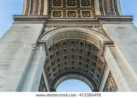 Arc de Triomphe de l'Etoile (1806-1836) is one of the most famous monuments in Paris. Arches are engraved names of military leaders of French Revolution and Empire, names of some great battles. - stock photo