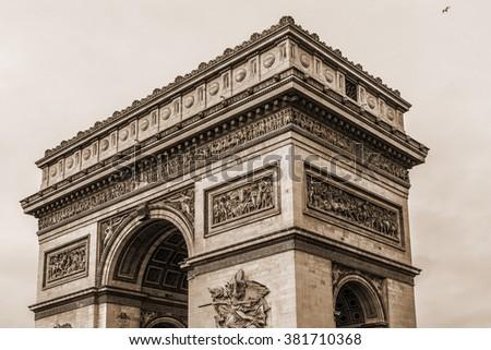Arc de Triomphe de l'Etoile on Charles de Gaulle Place, Paris, France. Arc is one of the most famous monuments in Paris. Vintage, sepia. - stock photo