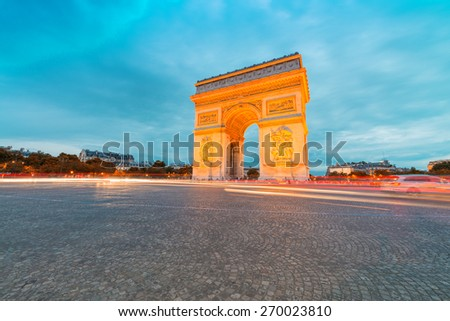 Arc de Triomphe illuminated at night, Paris. - stock photo