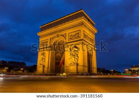 Arc de Triomphe in Paris at night, France - stock photo