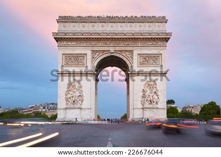 Arc de Triomphe in Paris, France. Traffic in the morning. - stock photo