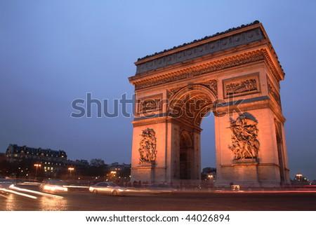 Arc de Triomphe, Paris, at night. Copy space on the left - stock photo