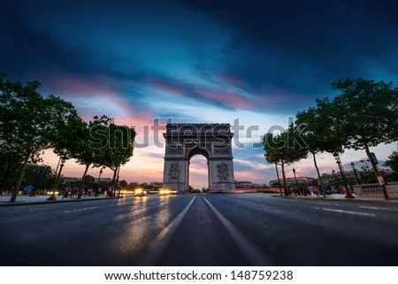Arc de triomphe Paris city at sunset - stock photo