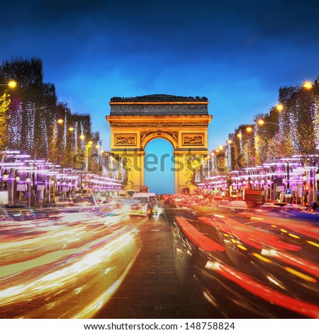 Arc de triomphe Paris city at sunset - Arch of Triumph and Champs Elysees - stock photo