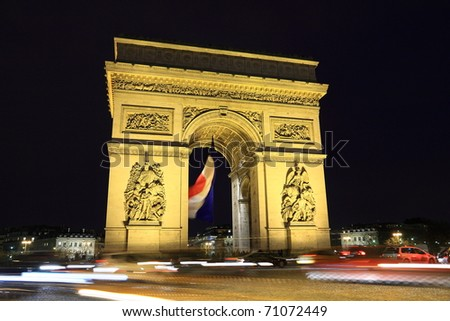 Arc in Paris Arc de triumph with french flag - stock photo