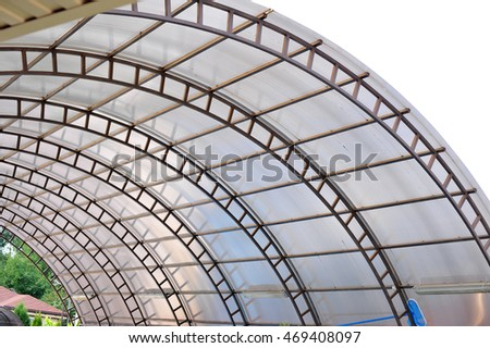 Arc Polycarbonate Canopy Against A Blue Sky