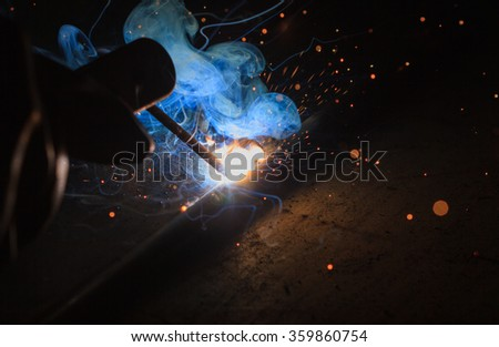 Arc welding and welding fumes - stock photo
