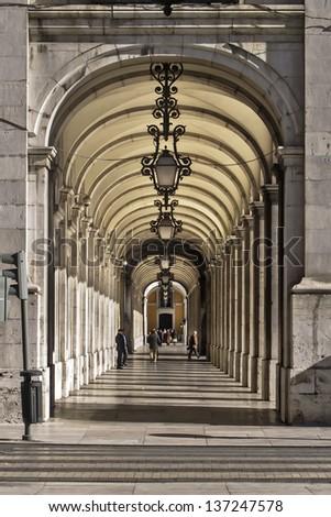 Arcade at downtown of Lisbon, Baixa district - stock photo