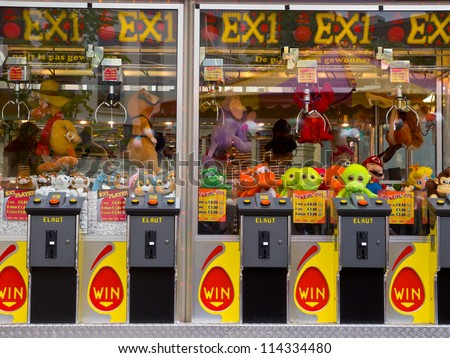 Arcade crane claw machine on an arcade in The Netherlands, Europe - stock photo