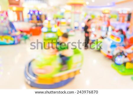Arcade game machine shop blur background with bokeh image . - stock photo
