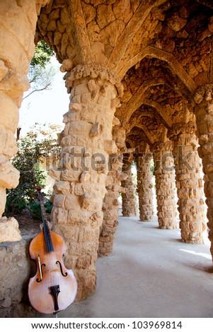 Arcade of masonry stone columns in Park Guell Barcelona of Gaudi modernism - stock photo