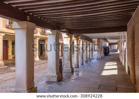 arcades in the streets of the old town in Alcala de Henares, Spain - stock photo