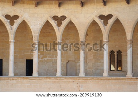 Arcades of Bellver Castle, a medieval castle in Palma de Mallorca, Spain.  - stock photo