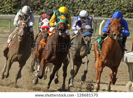 "ARCADIA, CA - FEB 16: Jockeys turn and head down the homestretch in the 3rd race at Santa Anita Park on Feb 16, 2013 in Arcadia, CA. Eventual winner is Kevin Krigger (outside) and ""Cee's the Year""."