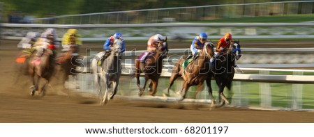 ARCADIA, CA - JAN 1: Two jockeys vie for the lead at the top of the stretch in the 7th race at Santa Anita Park on Jan 1, 2011 in Arcadia, CA. - stock photo