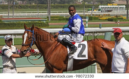 """ARCADIA, CA - MARCH 15: Kevin Krigger and """"Maui Mark"""" win the 2nd race at Santa Anita Park on March 15, 2012 in Arcadia, CA. - stock photo"""