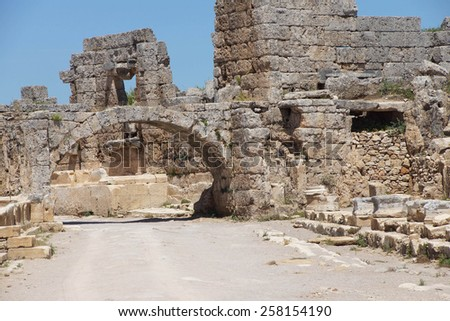 Arch and buildings  in the ancient Greek city of  Perge,  Turkey