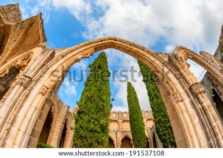 Arch and columns at Bellapais Abbey. Kyrenia. Cyprus - stock photo