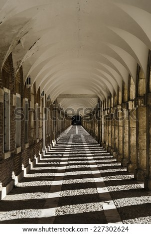Arch and columns, light and shadow effect - stock photo