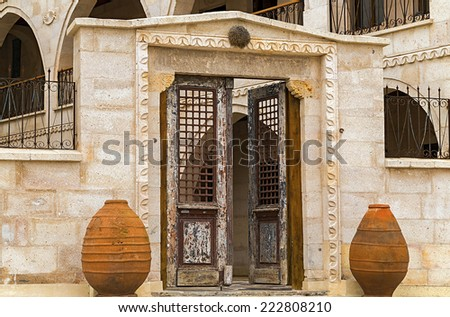 arch and old wooden door at a facade hotel in Cappadocia - stock photo