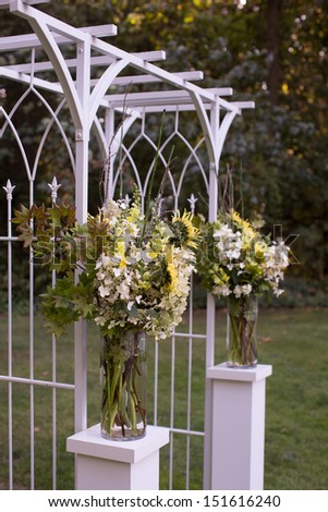 Arch at an Outdoor Wedding Ceremony - stock photo