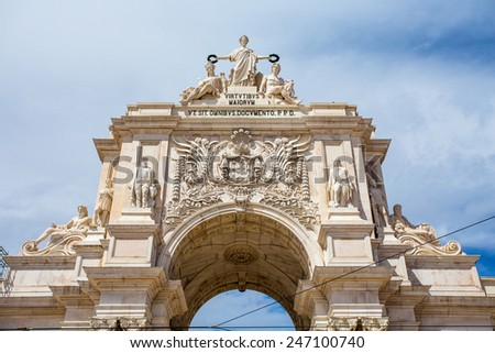 arch at commerce square at Lisbon, Portugal on a cloudy day - stock photo