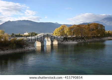 Arch bridge in City park ,China - stock photo