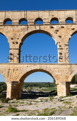 Arch Bridge of Pont du Gard, part of the ancient aqueduct of Nimes, France.
