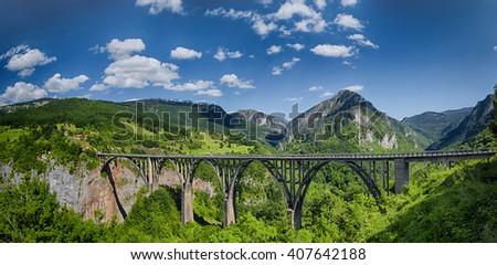 Arch bridge over the Tara River in northern Montenegro. - stock photo