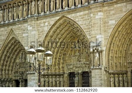 Arch entrance of Eglise Notre-Dame de Paris in France - stock photo