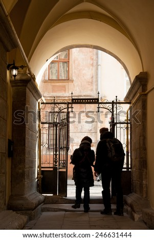 Arch entrance to old house in historic part of Lviv, Ukraine - stock photo