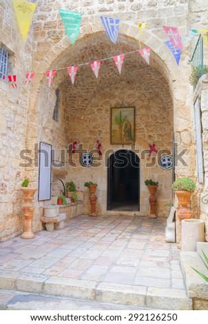 Arch entrance to The Monastery of Holy Cross, Orthodox monastery near the Nayot neighbourhood of Jerusalem, Israel  - stock photo
