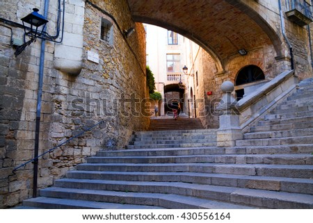Arch in the street Pujada de Sant Domenec, in the old quarter of Girona. Catalonia  - stock photo