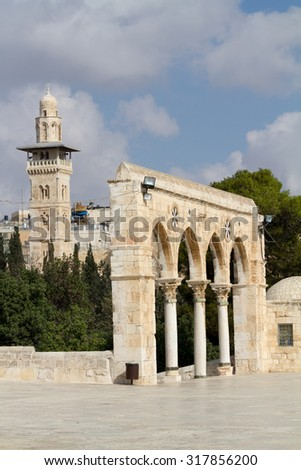 Arch next to Dome of the Rock, the most known mosque in Jerusalem. - stock photo