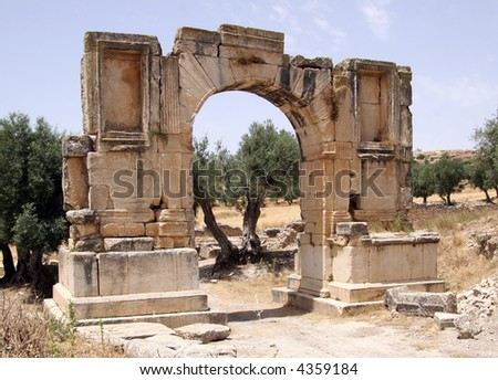Arch of Alexander Severus Dougga Roman Ruins Tunisia - stock photo