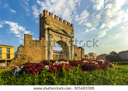 Arch of Augustus in Rimini, Italy - ancient romanesque gate of the city - historical italian landmark - stock photo