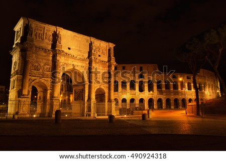 Arch of Constantine and The Colosseum at the Roman Forum in Rome at night, Italy