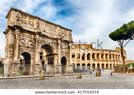 Arch of Constantine and The Colosseum at the Roman Forum in Rome, Italy - stock photo