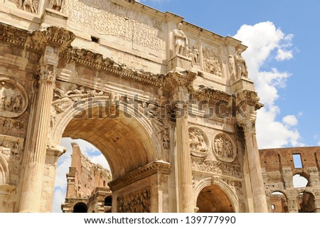 Arch of Constantine framing Colosseum on a sunny day in Rome, Italy - stock photo