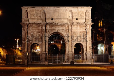 arch of Constantine with the Colosseum in background at night - stock photo