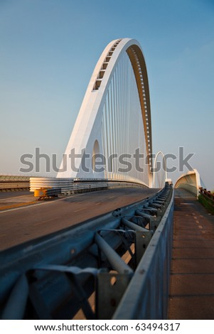arch of suspended bridge over the highway