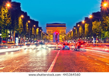 Arch of Triumph and Champs Elysees at dusk, Paris - stock photo