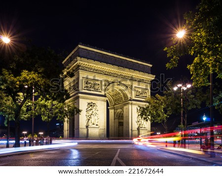 Arch of Triumph (Arc de Triomphe) at night with light trails, Paris, France
