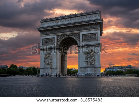 Arch of Triumph with dramatic sunset behind, Paris, France